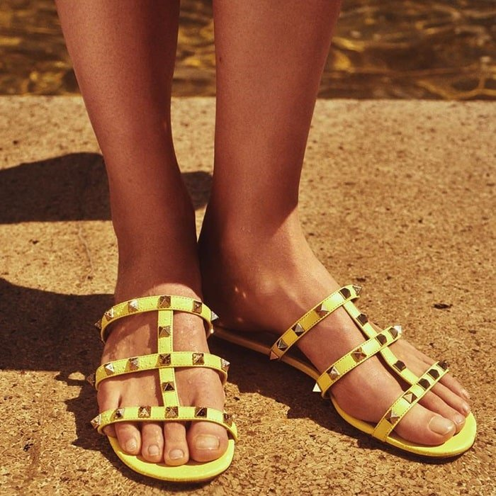 Slip into Valentino Garavani's Rockstud sandals for effortless sunshine style