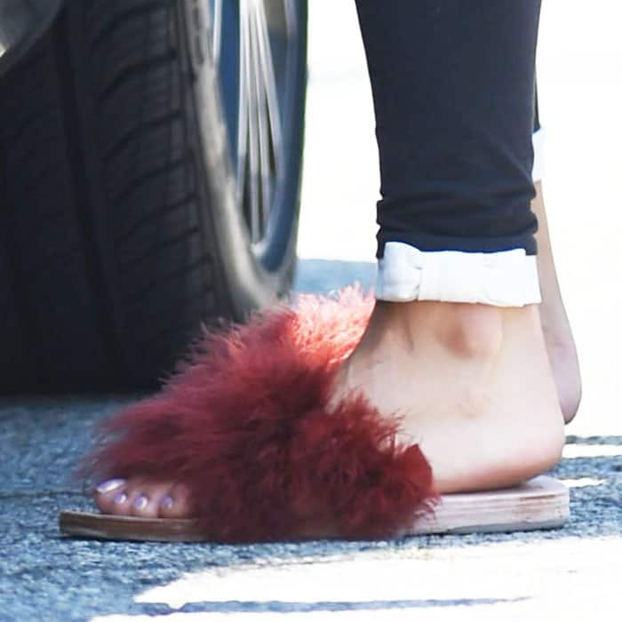 Vanessa Hudgens follows the fur slide trend with her yoga slippers