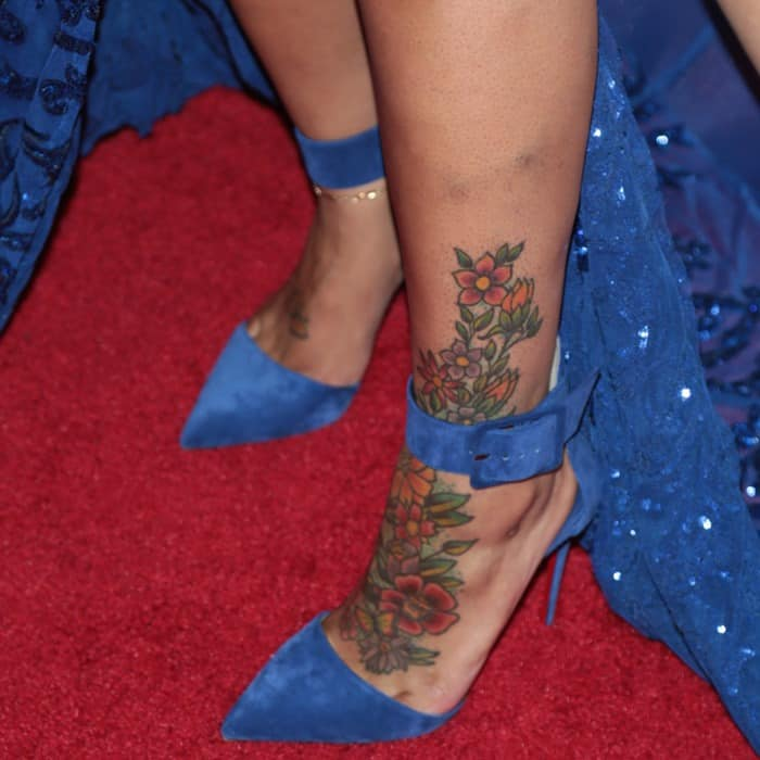 Blac Chyna showing off her foot tattoos in blue suede pointy-toe 'Harler' pumps from Christian Louboutin