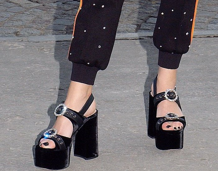 Anna Brewster wearing black embellished platform sandals at the Miu Miu Cruise 2018 fashion show during Paris Haute Couture Fashion Week