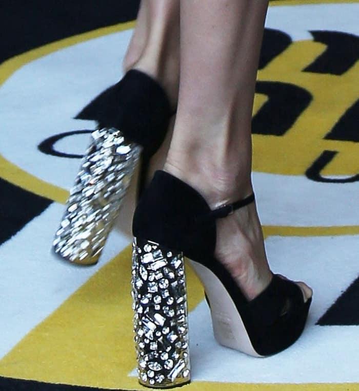 Doutzen Kroes wearing black embellished platform heels at the Miu Miu Cruise 2018 fashion show during Paris Haute Couture Fashion Week