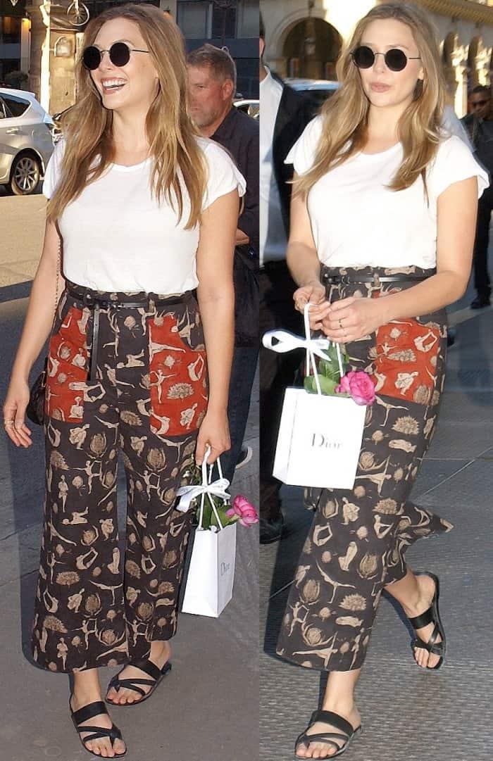 """Elizabeth Olsen attending the """"Christian Dior, Couturier Du Reve"""" exhibition launch"""