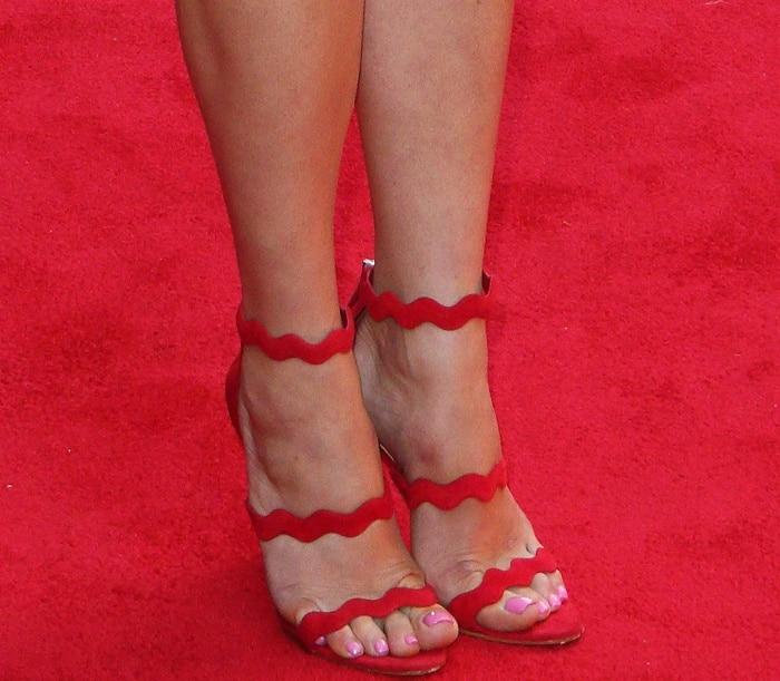 Gemma Arterton wearing Prada wave sandals in red suede at the Vue West End Cinema re-opening