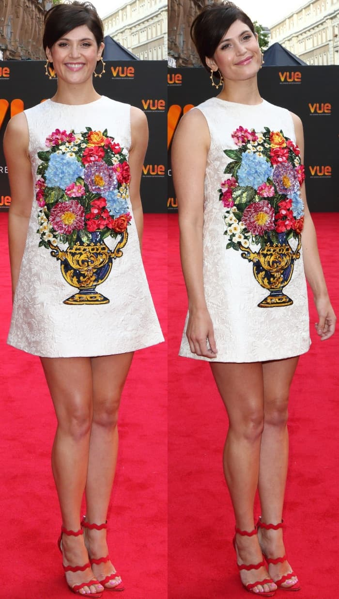 Gemma Arterton wearing a Dolce & Gabbana printed shift dress and red suede Prada heels at the Vue West End Cinema re-opening