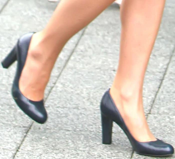 """Kate Middleton wearing a navy suit jacket with a matching navy skirt and L.K. Bennett """"Art"""" pumps"""