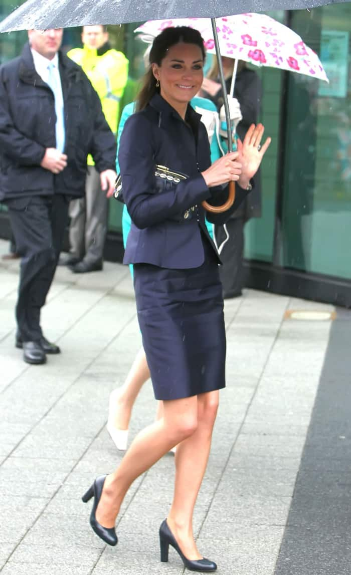 "Kate Middleton wearing a navy suit jacket with a matching navy skirt and L.K. Bennett ""Art"" pumps"