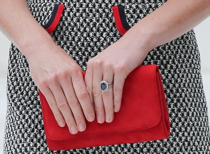 Kate Middleton carrying a red Emmy London clutch
