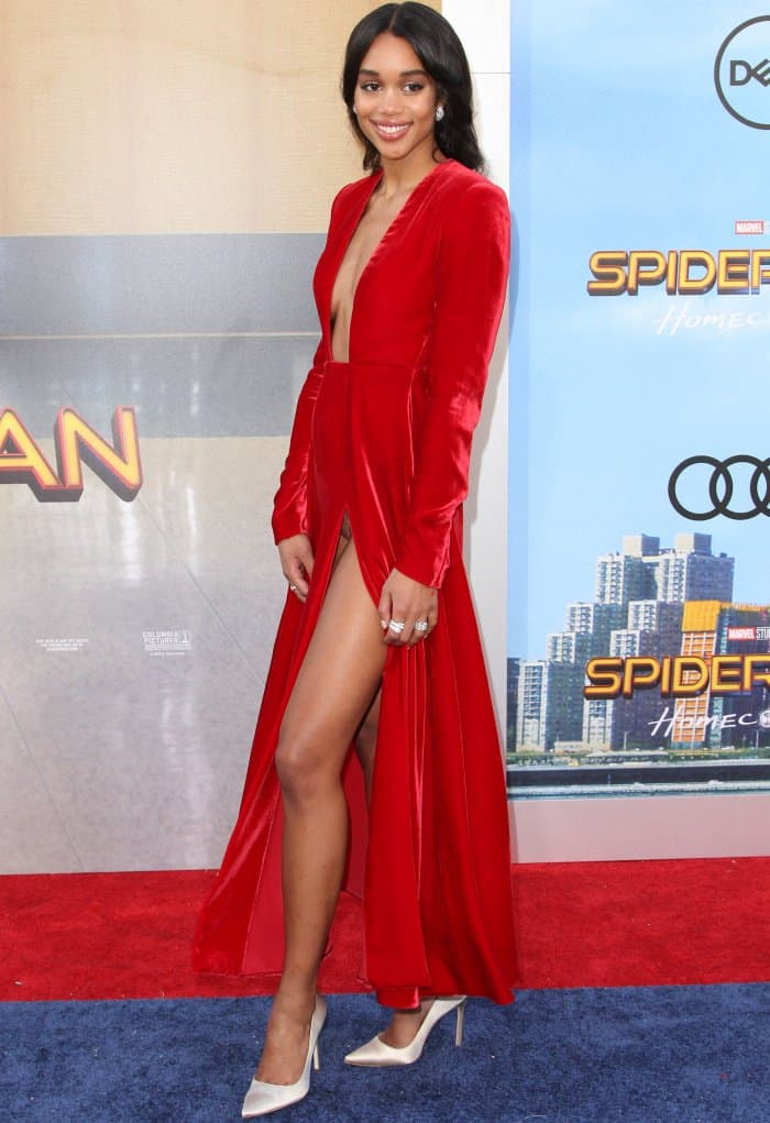 """Laura Harrier wearing a crimson Calvin Klein By Appointment velvet dress and white Manolo Blahnik satin pumps at the """"Spider-Man: Homecoming"""" LA premiere"""
