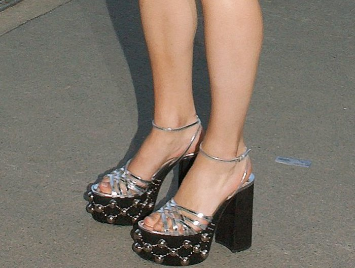 e3651223fed Stacy Martin wearing silver-and-black embellished platform sandals at the Miu  Miu Cruise