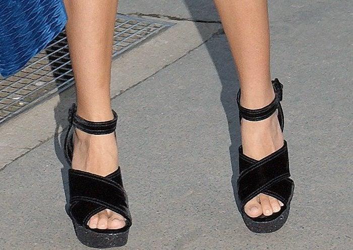 Teresa Palmer wearing black embellished platform sandals at the Miu Miu Cruise 2018 fashion show during Paris Haute Couture Fashion Week