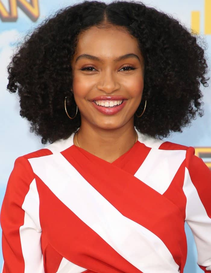 Yara Shahidi completed her look with loose curls