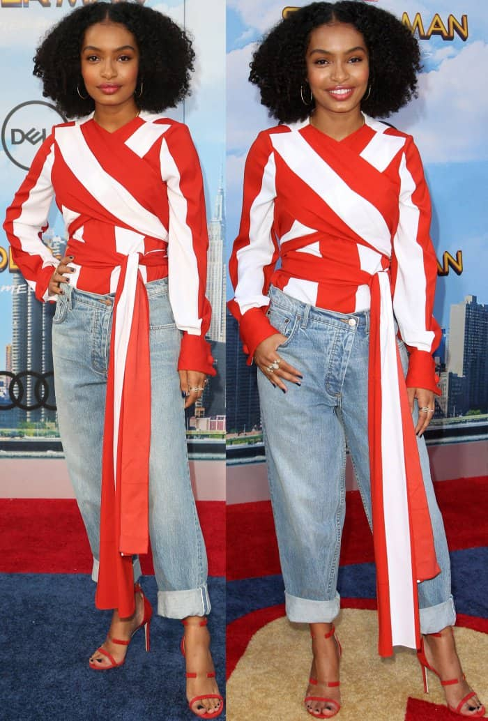 Yara Shahidi in a stretch-silk blouse with wide red-and-white stripes and wrap-around tie details on the waist