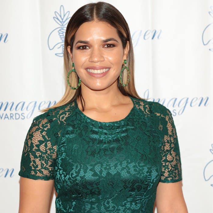 America Ferrera wearing an emerald green dress with lace overlay and accessorized with green hoop earrings