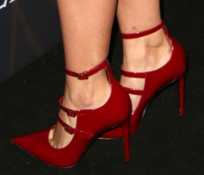 Ariel Winter shows off her legs in red triple strap pumps