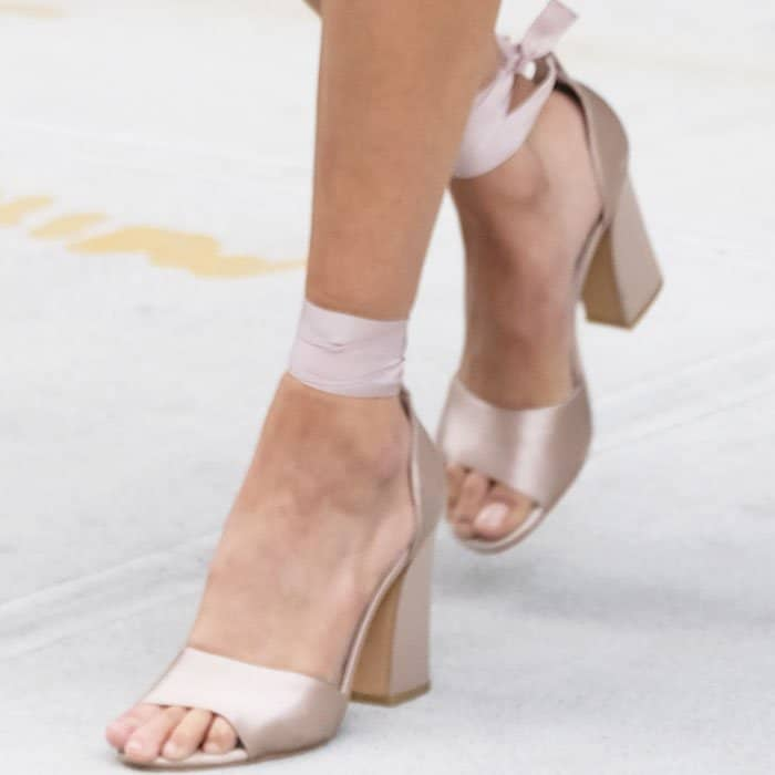 """Bella added a soft touch to her casual look with a pair of Dolce Vita """"Harvyy"""" sandals"""