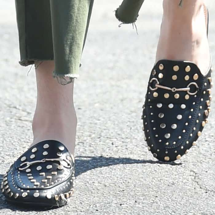 "Bella stylishly finished her outfit with a pair of Gucci ""Princetown"" studded mules"