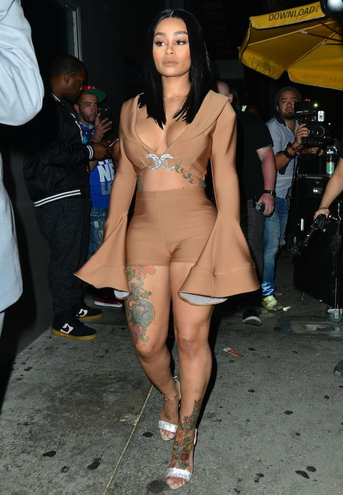 Blac Chyna hosts at Ace of Diamonds in nude shorts and crop top and Giuseppe Zanotti Sophie slingback sandals