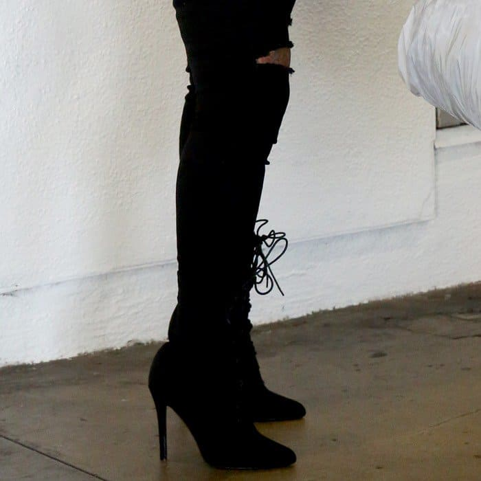 Blac Chyna wearing black knee-high suede boots