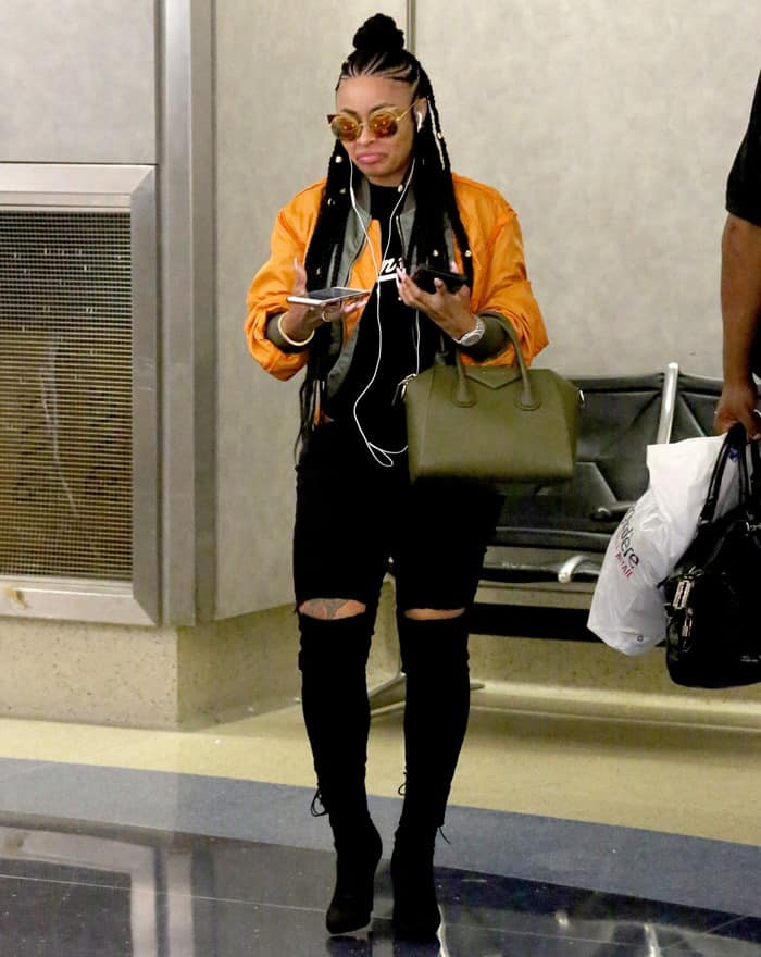 Blac Chyna Dresses Like A Rock Star In Orange Jacket And