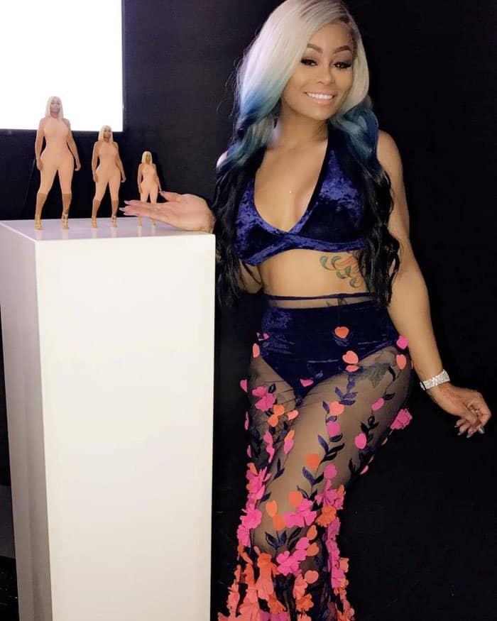 """Chyna poses beside her """"Rosebud"""" dolls"""