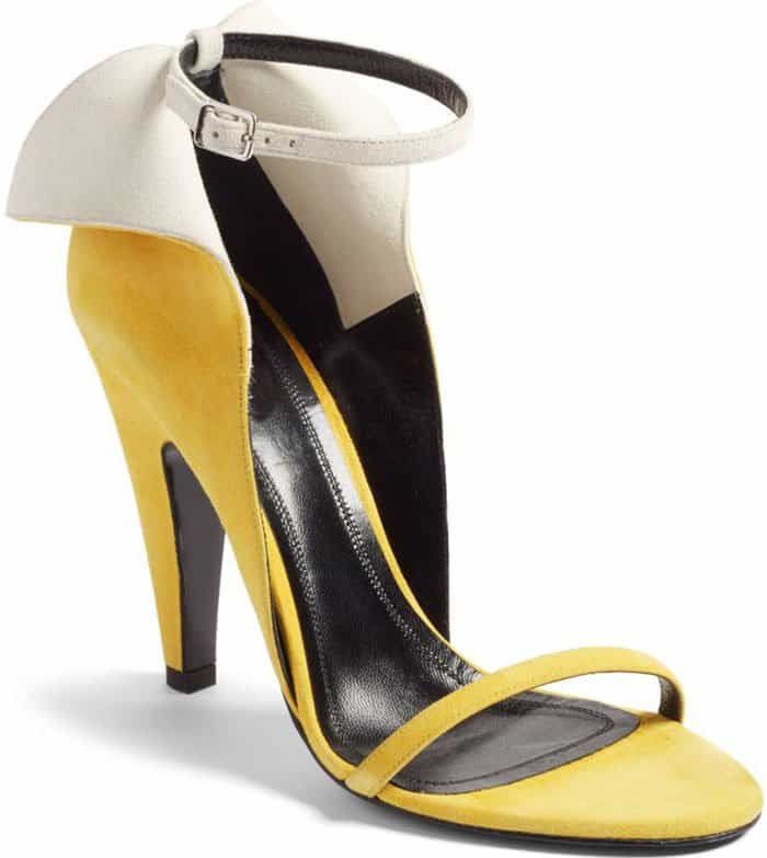 Add a fun, tropical feel to your look with this a-peeling sandal featuring a split counter and svelte ankle and toe straps