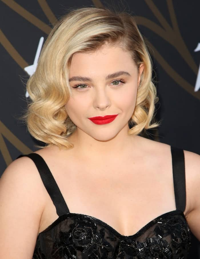 Chloe Moretz complemented her '50s glam look with a wavy bob and bright red lips