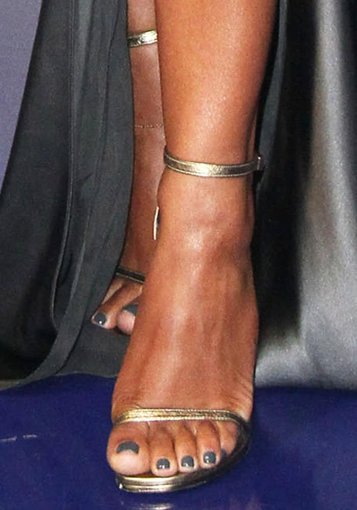 """Christina adds a slight touch of copper with a pair of Saint Laurent """"Jane"""" sandals"""
