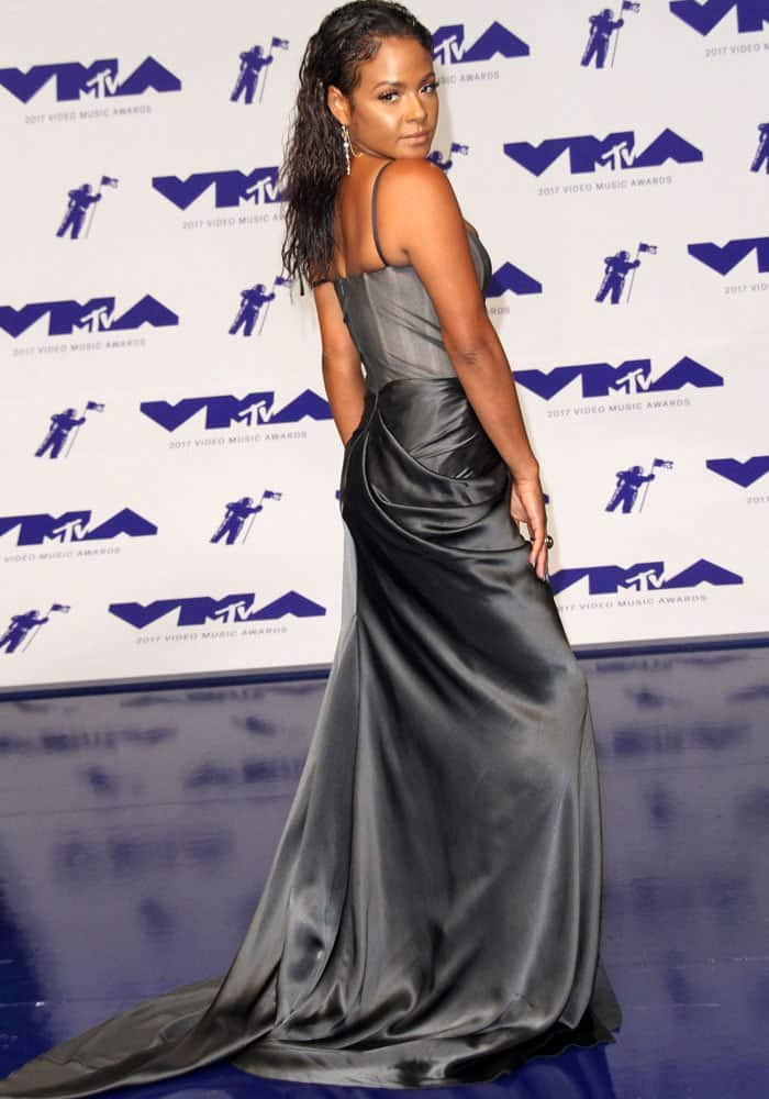 The singer shows off the back of her satin couture dress