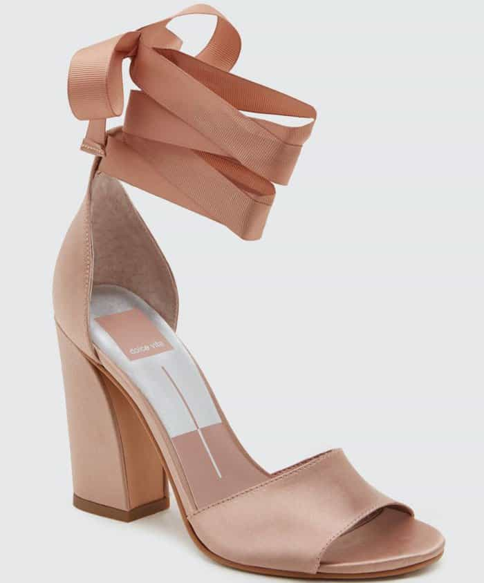 A grosgrain ribbon ankle strap provides a perfectly poised finish for this stunning satin sandal
