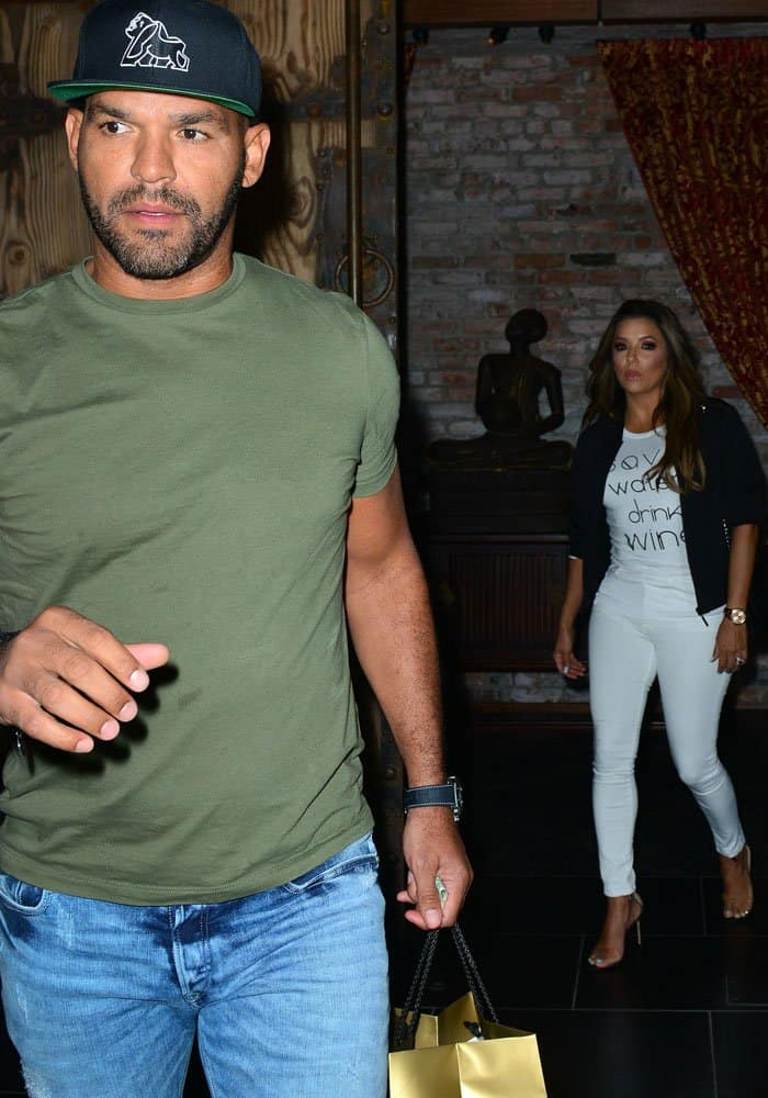 Husband Jose Baston goes ahead of the actress to open the car door for her