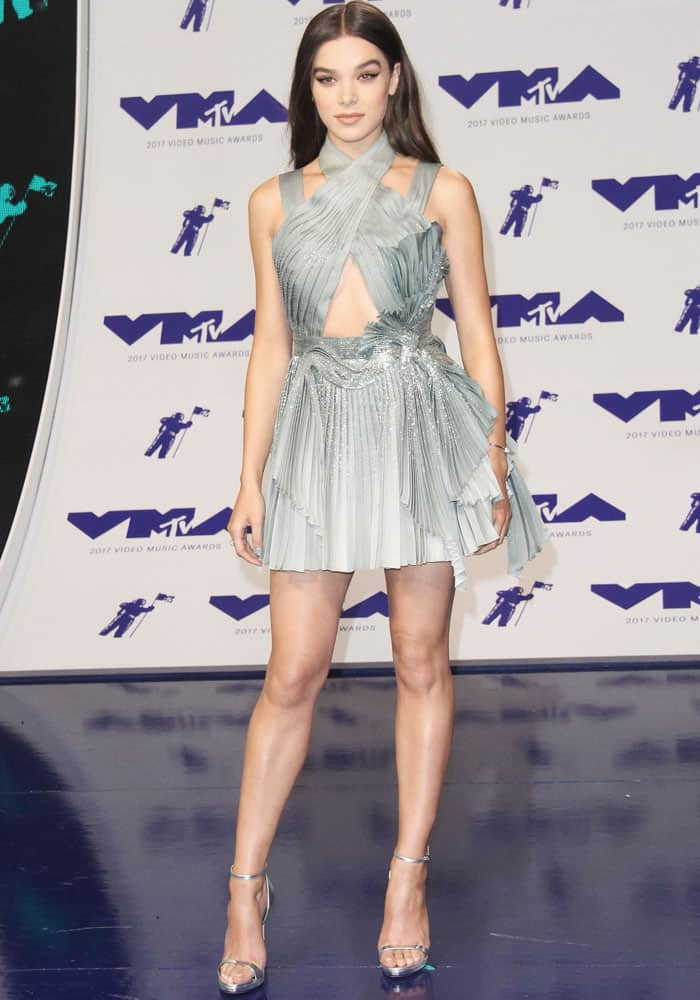 Hailee sparkles in a pleated short dress by Versace