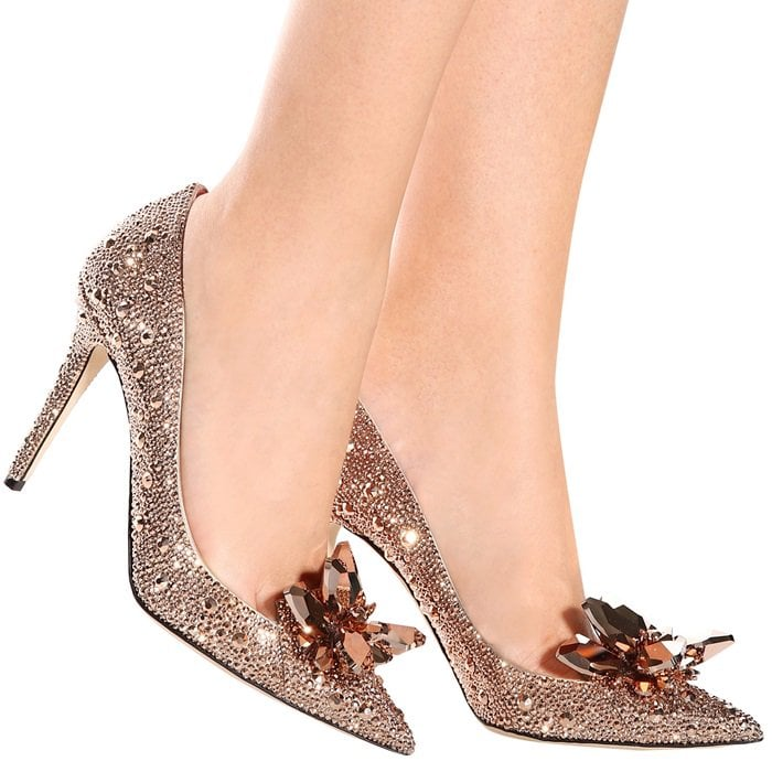 Large jewels embellish the pointed toe, enhancing the drama of the exquisite stiletto-heeled piece