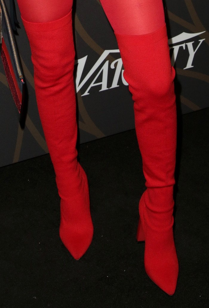 Jenna Ortega in red Tommy Hilfiger thigh-high boots
