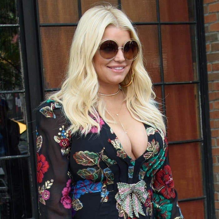 Jessica Simpson wearing a floral embroidered Gucci dress when leaving her hotel in New York City on August 10, 2017