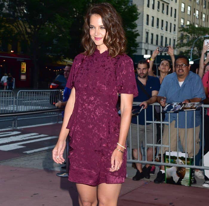 Katie Holmes sizzled in a Maison Mayle dress that is crafted of burgundy floral silk jacquard