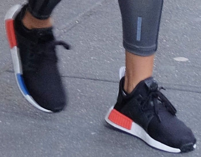 "The model stayed fashionable in a pair of Adidas ""NMD RX1"" sneakers"