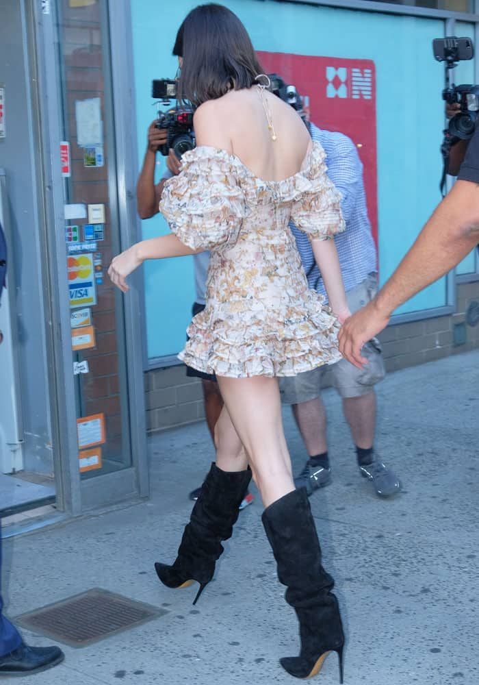 Kendall shows off the low cut back of her ruffled Zimmermann dress