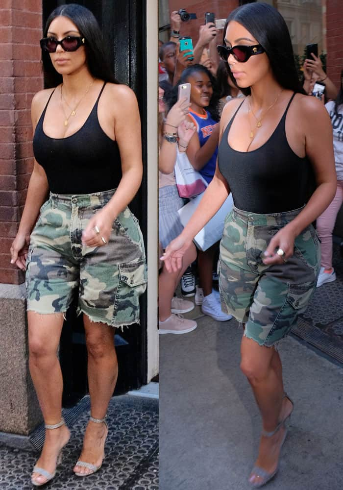 Kim goes for grunge-meets-sophisticated in a sheer black top and oversized camo shorts