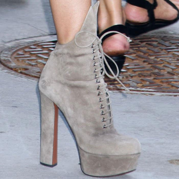 LeaAnn towered in a pair of Alaïa suede platform boots