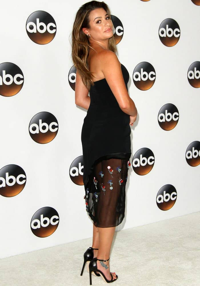 Lea shows off the back of her Cushnie et Ochs dress