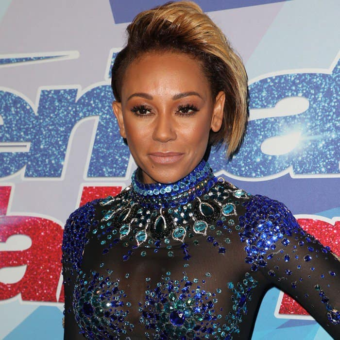Mel B flaunted her curves in a see-through bodysuit from Rocky Gathercole  with blue 36194c6a1