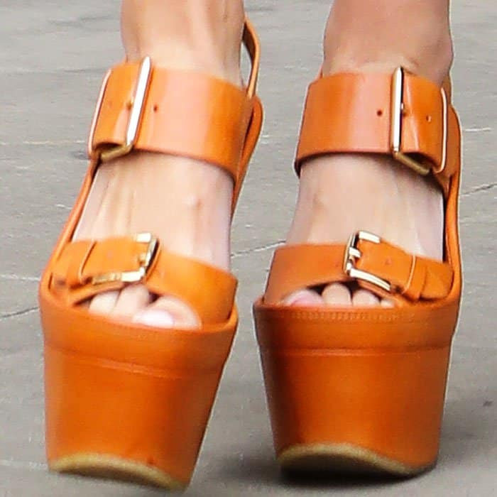 Mollie makes an unlikely pairing with the towering Stella McCartney platform sandals