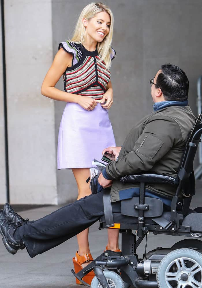 Mollie talks to one of the fans outside BBC Studios