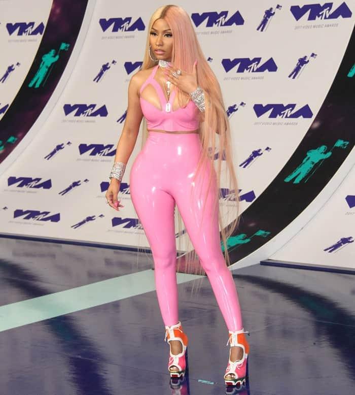 Nicki Minaj styled her bubblegum pink latex bodysuit with a colorful pair of peep-toe heels