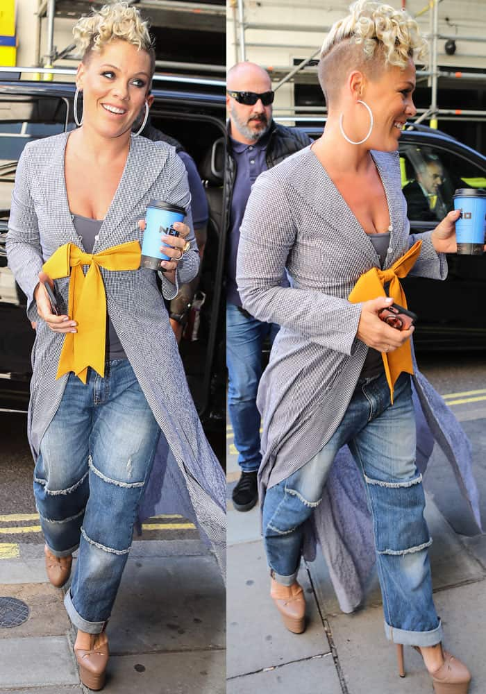 Pink was all-smiles as she emerged in London wearing a bow front jacket