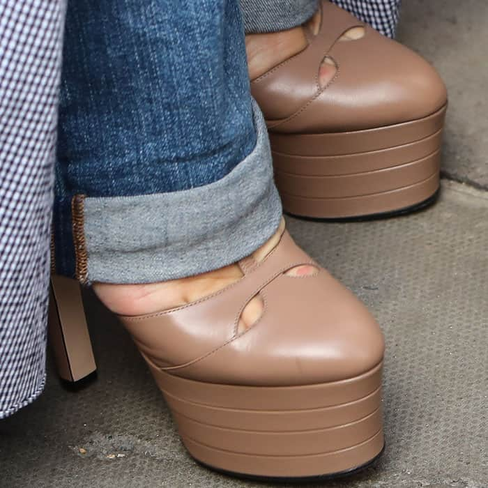 """The singer towered in a pair of Gucci """"Angel"""" mary jane pumps"""