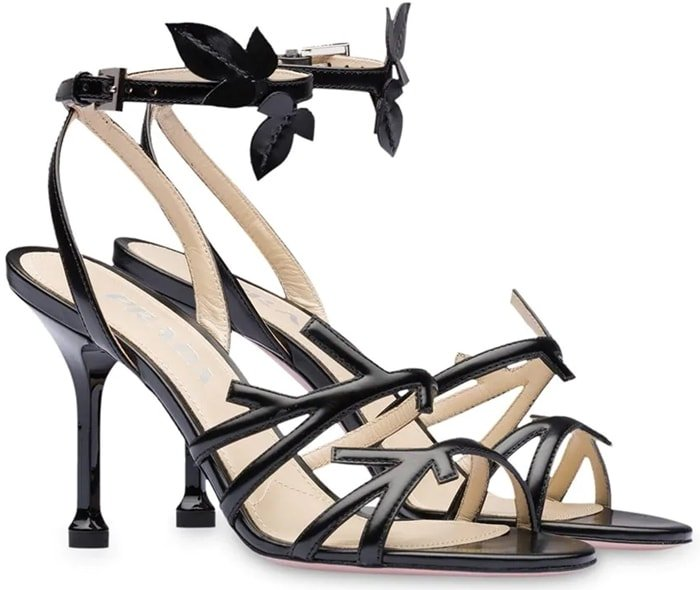 These black leather foliate-style 90mm sandals from Prada are a subtly stylish and utterly wearable pair