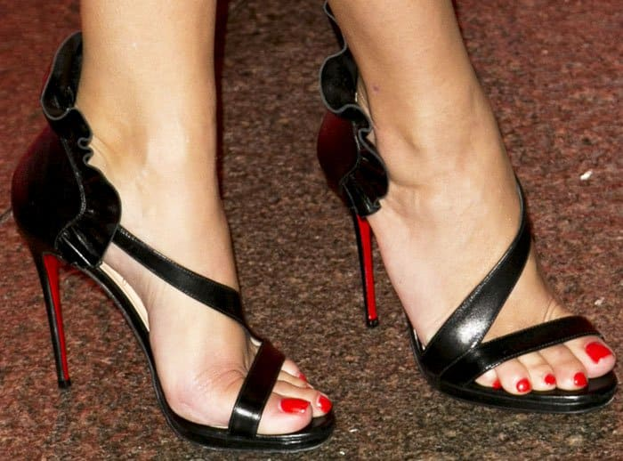 "Reese adds a dash of fun into her ensemble with the Christian Louboutin ""Colankle"" sandals"