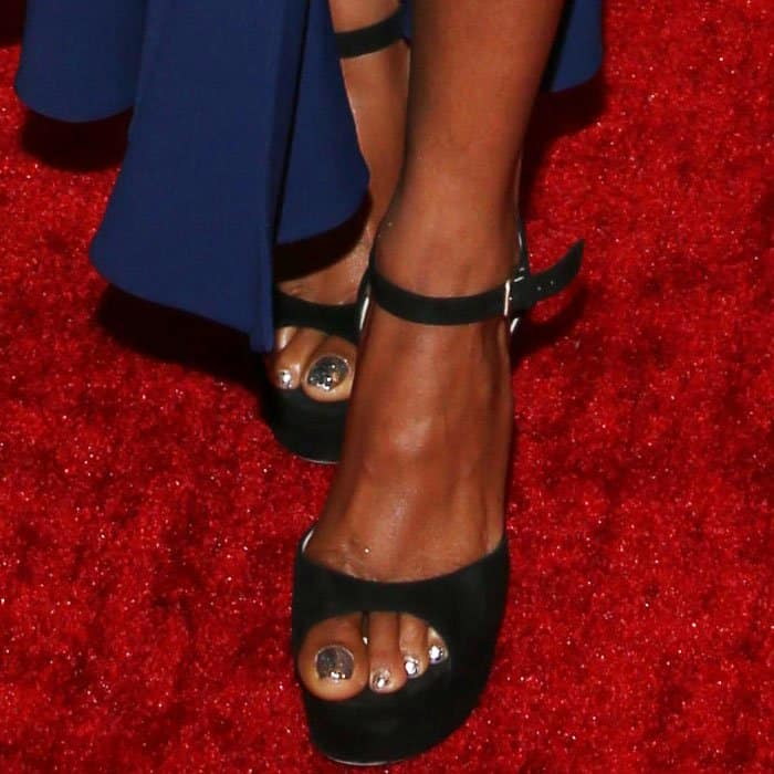 Taraji towered in a pair of Jimmy Choo platform sandals