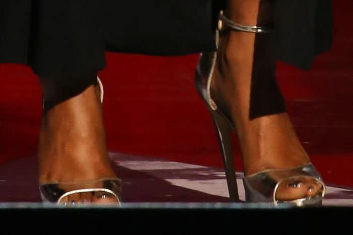 Taraji switches out her black platform sandals for a silver pair